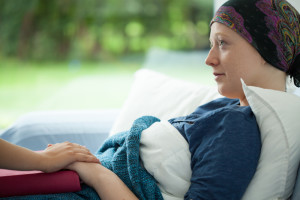 image of woman with cancer being cared for